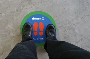 real estate agent's shoes on a 'stand here' floor decal for VR orientation