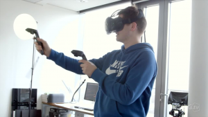User inside a tethered VR headset, HTC Vive