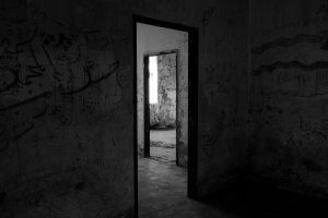 Abandoned rooms in a dark house.