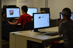 Children designing 3D models on computers