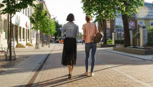 2 women walking side by side