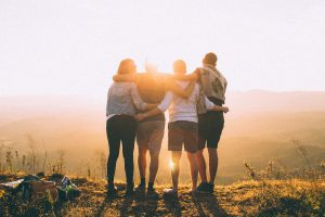Friends hugging looking at the sunset
