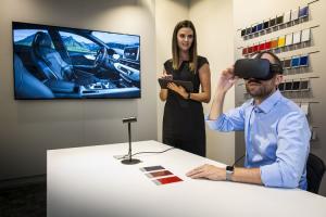 Man wearing VR headset customizing his car